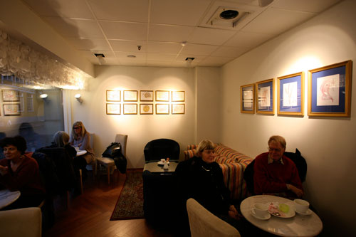 Guests enjoying coffee and the Jharna Kala art of Sri Chinmoy