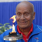 Sri Chinmoy with World Harmony Run torch